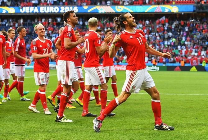 Rediff Sports - Cricket, Indian hockey, Tennis, Football, Chess, Golf - Euro 2016: Northern Ireland own goal sends Wales into last 8