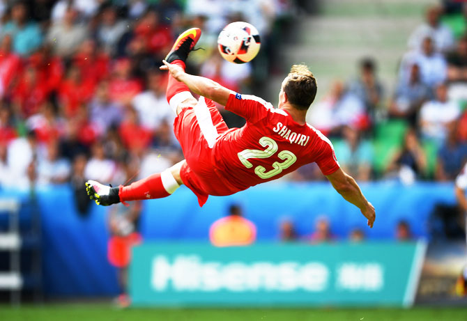 Rediff Sports - Cricket, Indian hockey, Tennis, Football, Chess, Golf - Shaqiri's overhead goal draws similarities with goals of yore