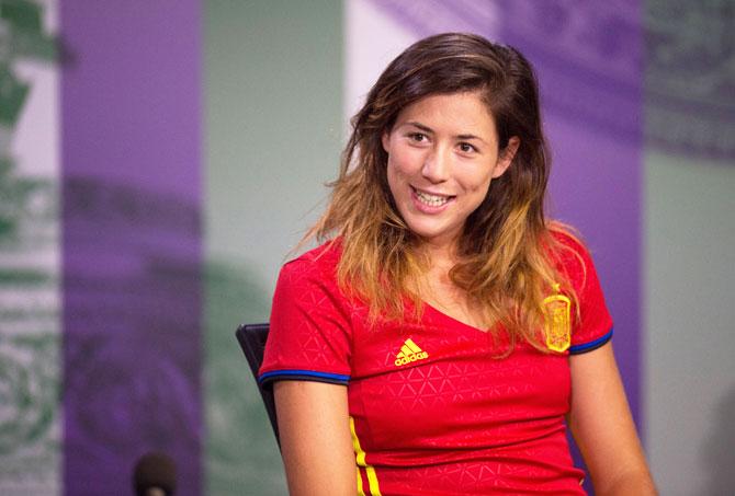 Rediff Sports - Cricket, Indian hockey, Tennis, Football, Chess, Golf - Without Rafa, Muguruza flies Wimbledon flag for Spain