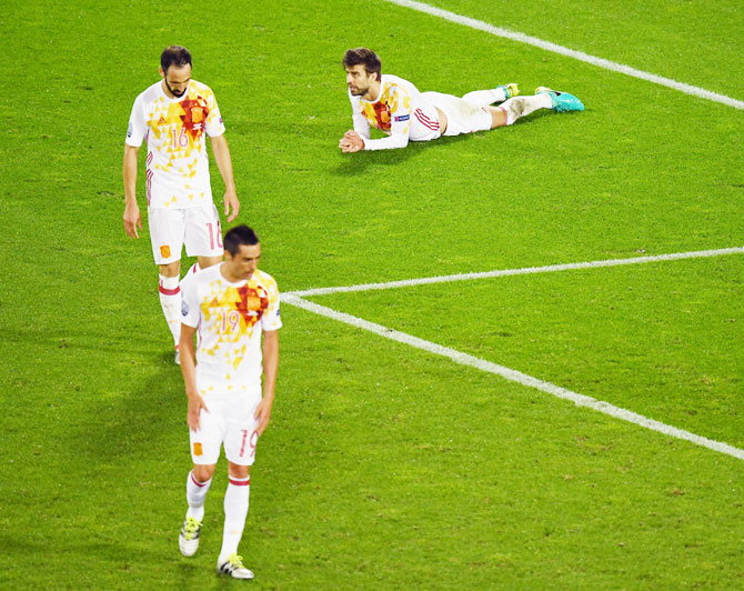 Spain's Bruno Soriano, Juanfran and Gerard Pique