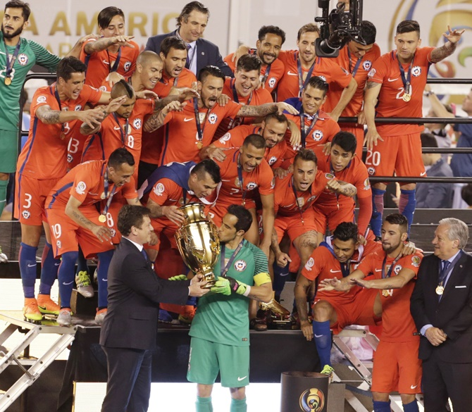 Rediff Sports - Cricket, Indian hockey, Tennis, Football, Chess, Golf - Chile clinch Copa America title in shootout