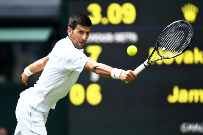 Serbia's Novak Djokovic plays a backhand shot during his Wimbledon first round match against England's James Ward at the All England Lawn Tennis and Croquet Club in London on Monday
