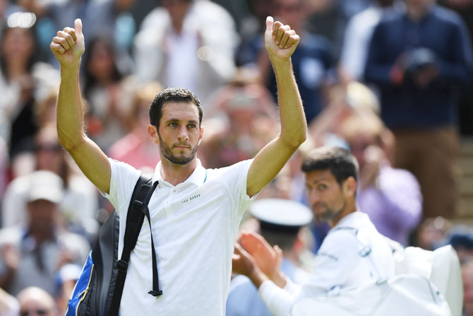 James Ward applauds supporters following his defeat against Novak Djokovic
