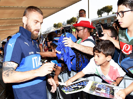 Italy's Daniele De Rossi signs autographs in Montpellier, France, on Wednesday