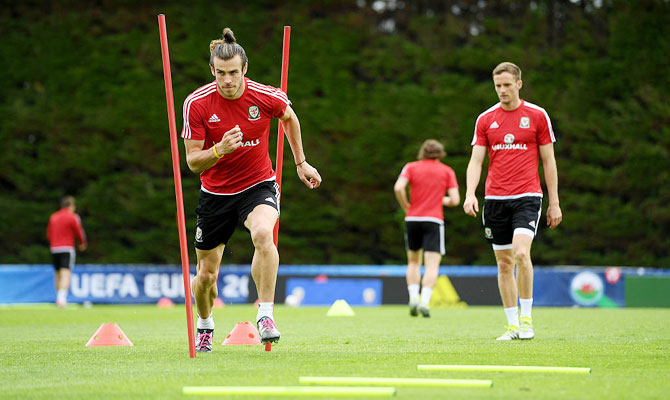 Wales' Gareth Bale goes through the grind during a team training session at their Euro 2016 base camp in Dinard, France, ahead of their quarter-final match against Belguim, on Tuesday