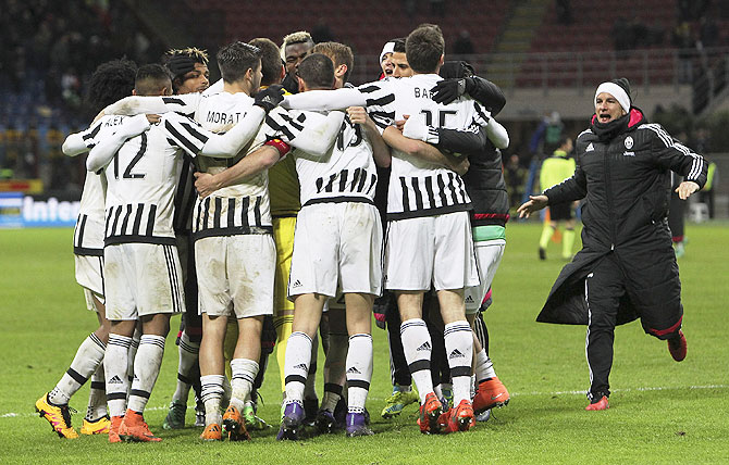 The players of the Juventus FC celebrate a victory at the end of the TIM Cup match between FC Internazionale Milano and Juventus FC at Stadio Giuseppe Meazza