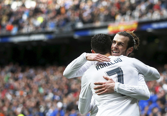 Real Madrid's Gareth Bale celebrates his goal against Celta Vigo with teammate Cristiano Ronaldo