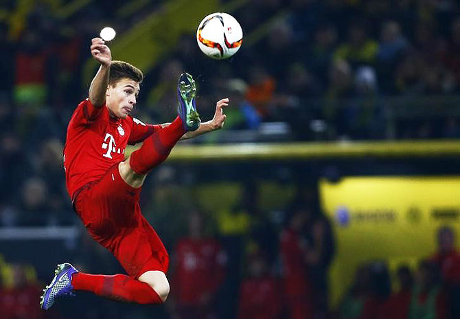 Bayern Munich's Joshua Kimmich attempts to score against Borussia Dortmund during their Bundesliga match at Signal Uduna Park in Dortmund on Saturday