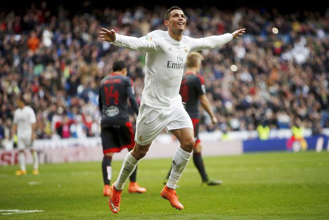 Real Madrid's Cristiano Ronaldo celebrates his fourth goal against Celta Vigo during their La Liga match at Santiago Bernabeu stadium, in Madrid on Saturday