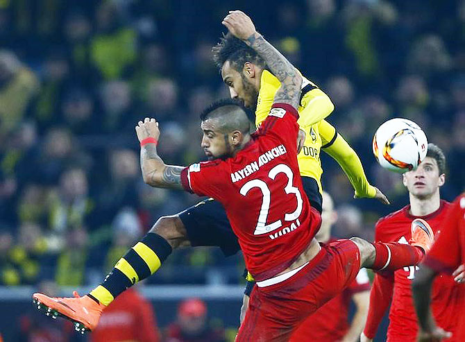 Bayern Munich's Arturo Vidal and Borussia Dortmund's Pierre-Emerick Aubameyang are involved in a challenge