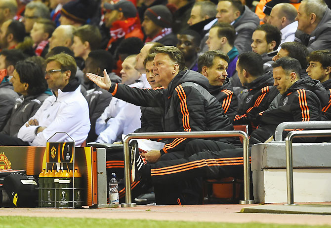 Manchester United manager Louis van Gaal reacts on the bench on Thursday