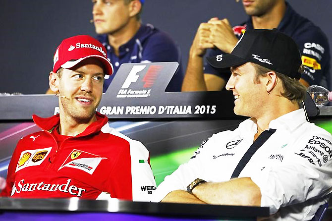 Ferrari's Sebastian Vettel and Mercedes' Nico Rosberg during a press conference