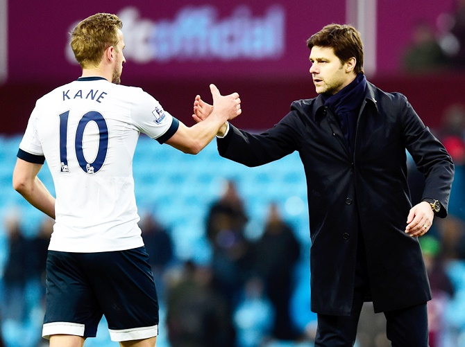 Mauricio Pochettino manager of Tottenham Hotspur and Harry Kane shake hands after victory