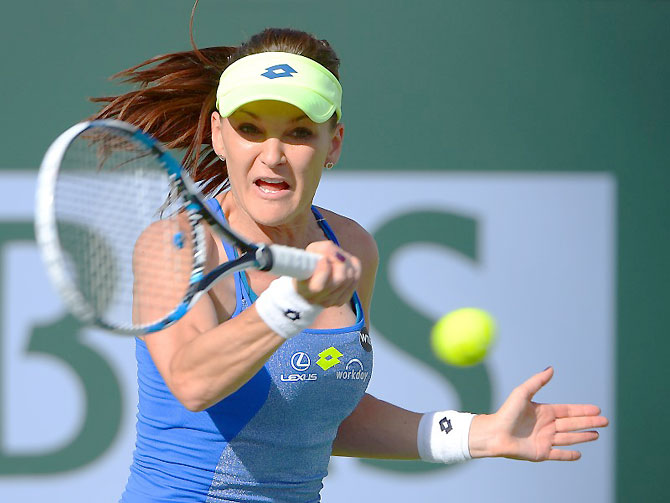 Poland's Agnieska Radwanska in action against Dominika Cibulkova