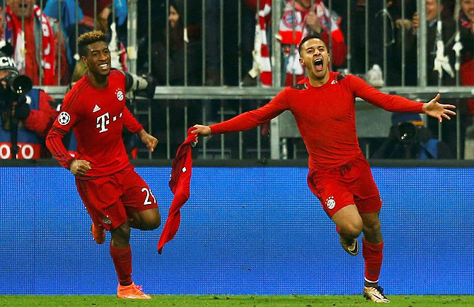 Bayern Munich's Thiago Alcantara (right) celebrates with Kingsley Coman after scoring a goal against Juventus on Wednesday