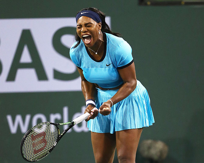 USA's Serena Williams celebrates a point in her match against Romania's Simona Halep