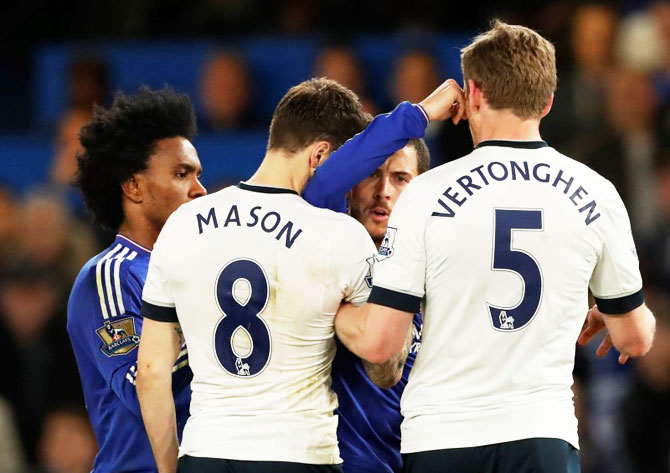 Tottenham's Ryan Mason clashes with Chelsea's Eden Hazard