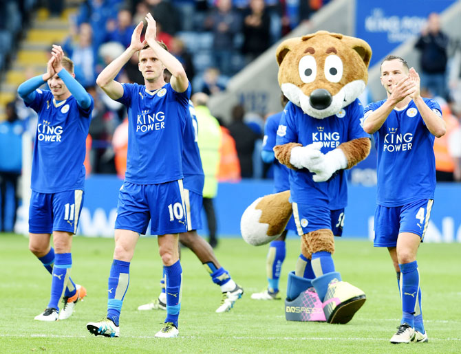 Leicester City players celebrate at the end of a Barclays Premier League match against Swansea City at the King Power Stadium on April 24