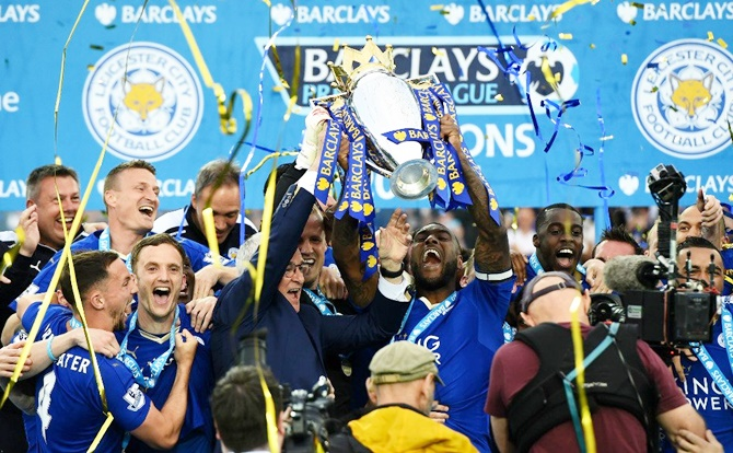 Leicester City players celebrate with the EPL trophy on May 8