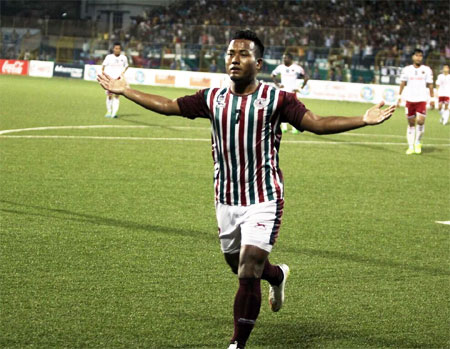 Mohun Bagan's Jeje Lalpekhula celebrates a goal against Lajong during their Fed Cup match in Barasat on Sunday