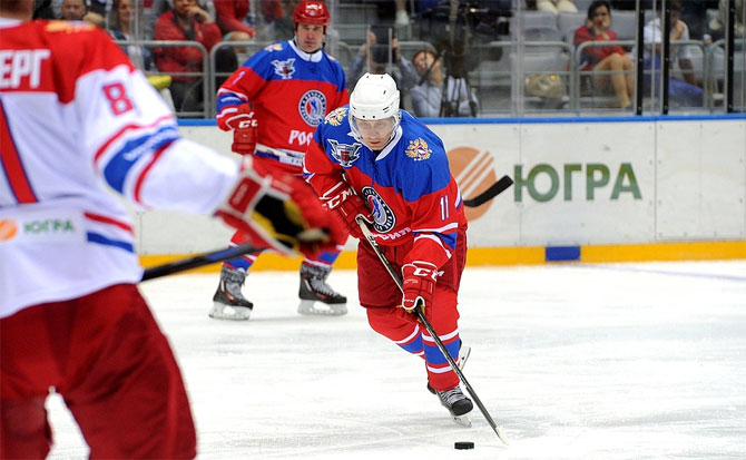 Russian President Vladimir Putin in action during a gala game of the Night Ice Hockey League in Sochi, Russia, on Tuesday