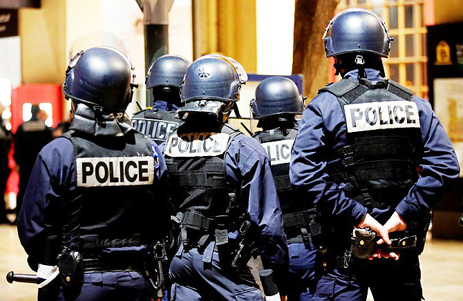French riot policemen attend a drill at the Marseille railway station, in France in preparation of security measures for the UEFA 2016 European Championship