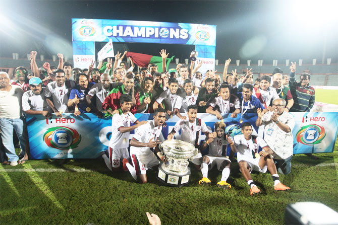 Mohun Bagan players and officials celebrate with the Fed Cup trophy on Saturday