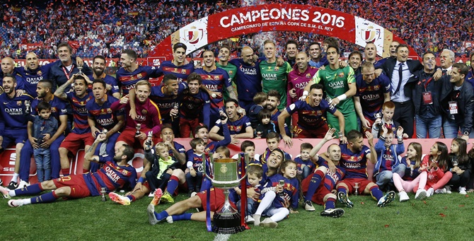 Rediff Sports - Cricket, Indian hockey, Tennis, Football, Chess, Golf - King's Cup PIX: Barca complete double with win over Sevilla