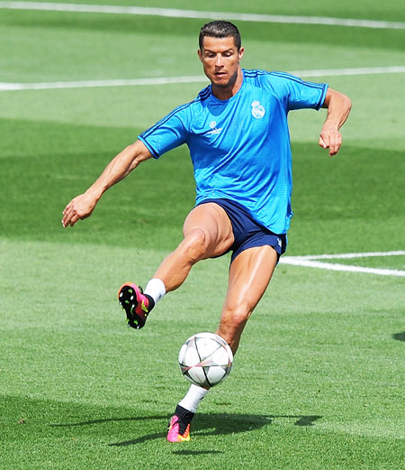 Real Madrid's Cristiano Ronaldo controls the ball during a team training session at the Real Madrid Open Media Day ahead of the UEFA Champions League final against Club Atletico Madrid at Valdebebas training ground in Madrid on Tuesday