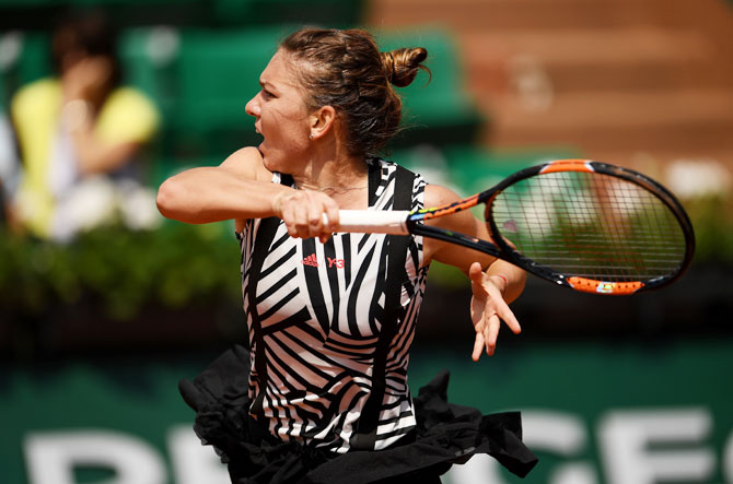 Romania's Simona Halep whips a return against Japan's Naomi Osaka during their French Open third round match at the Roland Garros on Friday