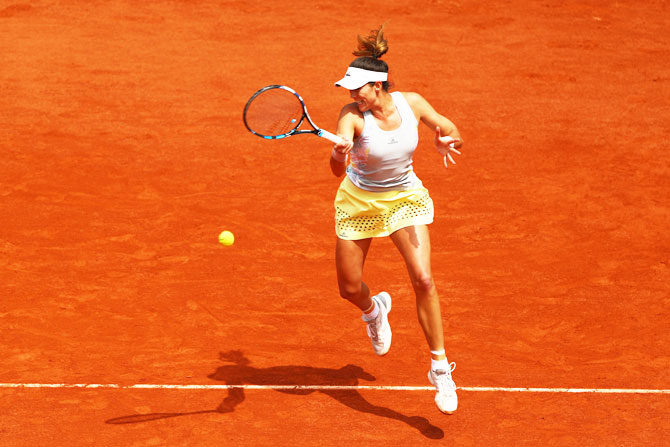 Spain's Garbine Muguruza hits a forehand against France's Myrtille Georges during their French Open second round match