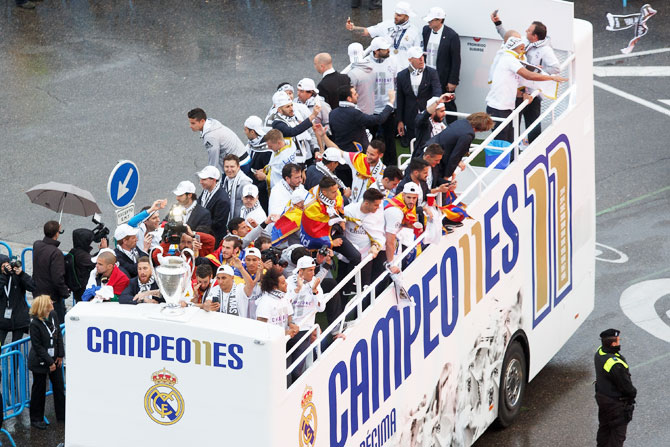 Rediff Sports - Cricket, Indian hockey, Tennis, Football, Chess, Golf - PHOTOS: Kings of Europe Real Madrid take celebrations to the street