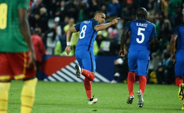 Dimitri Payet celebrates after scoring the winner against Cameroon on Monday