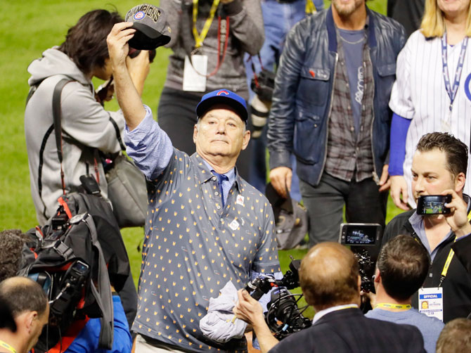 Hollywood actor Bill Murray celebrates on the field after the Chicago Cubs defeated the Cleveland Indians 8-7