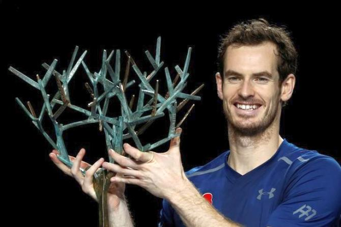 Andy Murray with the Paris Masters trophy after defeating USA's John Isner on Sunday