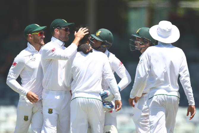 South Africa's Jean-Paul Duminy gets a kiss from 'keeper Quinton de Kock after dismissing Australia's Usman Khawaja in the first Test at the WACA in Perth