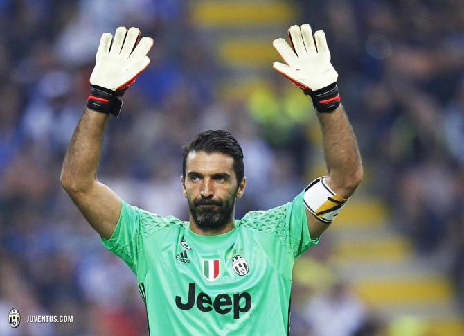 Gianluigi Buffon acknowledges the crowd as he comes on to play his 600th Serie A match on Sunday