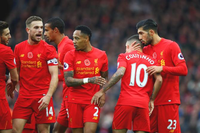 Liverpool's Philippe Coutinho celebrates with teammates after scoring his side's second goal