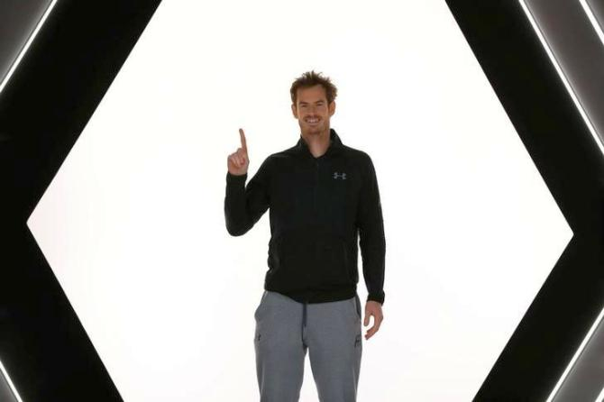 World No 1 Andy Murray poses for pictures after winning the Paris Masters on Sunday