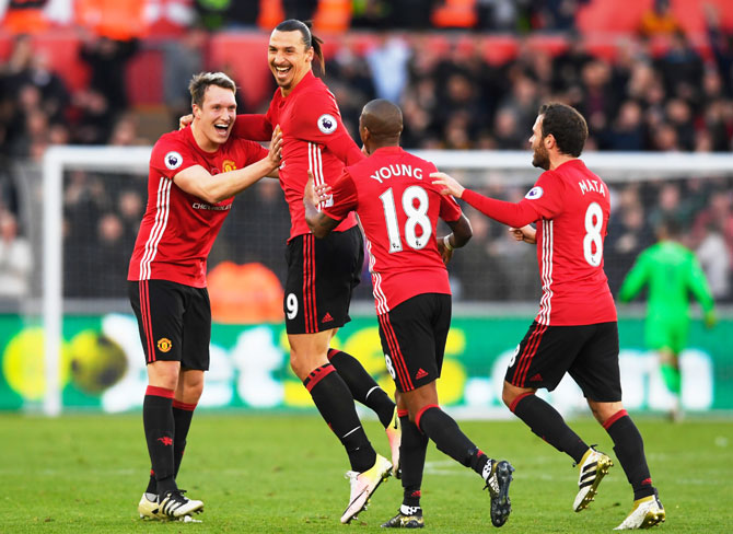 Manchester United's Zlatan Ibrahimovic celebrates scoring a goal with teammates
