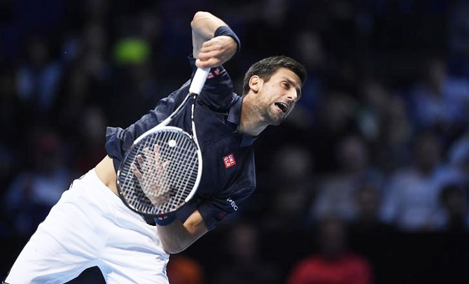 Serbia's Novak Djokovic in action against Austria's Dominic Thiem during their round-robin match at the ATP World Tour Finals at the O2 Arena in London on Sunday