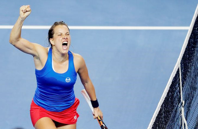 Czech Republic's Barbora Strycova celebrates her victory against France's Alize Cornet in the Fed Cup final in Strasbourg, France, on Sunday