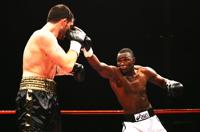 Francis Cheka (right) throws a punch