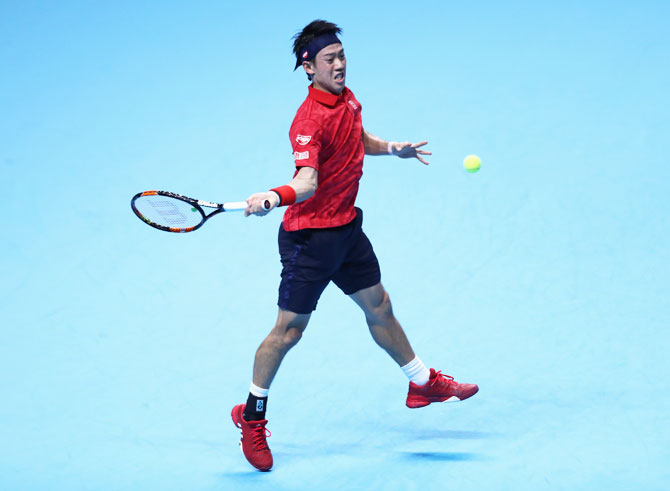 Japan's Kei Nishikori plays a forehand during the men's singles match against Switzerland's Stan Wawrinka on day two of the ATP World Tour Finals at the O2 Arena in London on Monday