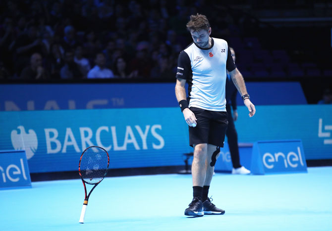 Stan Wawrinka drops his racquet in frustration during his match against Kei Nishikori