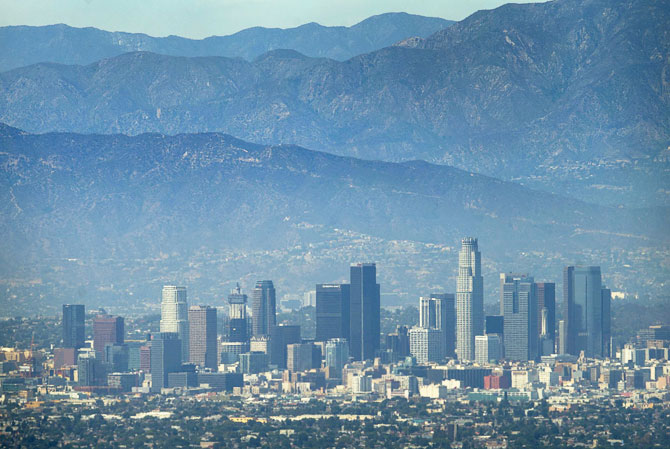 The city of Los Angeles, California is pictured on a hot summer day next to the San Gabriel mountains August 5, 2015