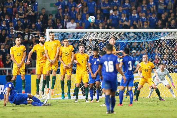 Thailand's Teerasil Dangda (left) has his free kick blocked by the Australian wall during their World Cup qualifier in Rajamangala National Stadium, Bangkok, on Tuesday