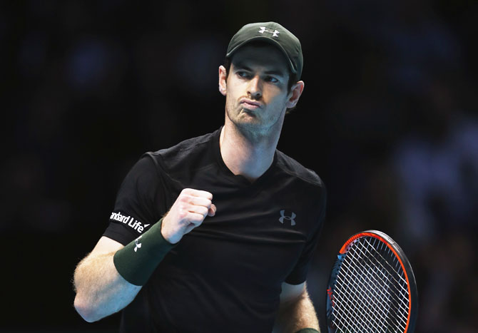 Great Britain's Andy Murray celebrates winning the first set in his men's singles match against Switzerland's Stan Wawrinka on day six of the ATP World Tour Finals at O2 Arena in London on Friday