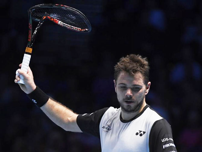 Stanislas Wawrinka with a broken racquet during his round robin match against Andy Murray