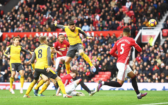 EPL PHOTOS: Arsenal draw vs United, Liverpool held